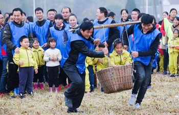 Rice field recreational activity held in E China's Zhejiang