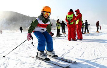 People enjoy skiing across China