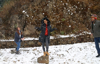 People enjoy first snowfall in Kathmandu, Nepal