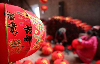 People make red lanterns in Luozhuang, N China's Hebei