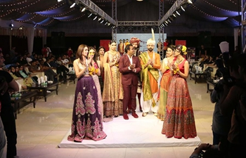 Models present creations at fashion show in Islamabad