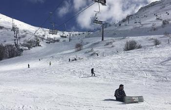 People ski at Mount Hermon ski resort in Golan Heights