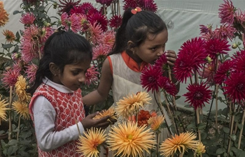 Children visit flower show in Kolkata, India