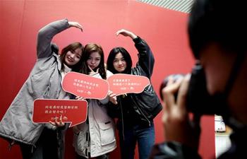 Passengers have photos taken in Jinan West Railway Station