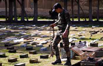 Confiscated weapons seen in military base in countryside of Damascus, Syria