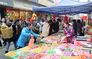 People buying goods in Guizhou for upcoming Spring Festival
