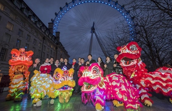 London Eye lit up in red and gold to celebrate Chinese New Year