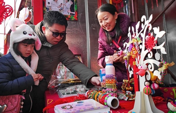 People enjoy themselves at Spring Festival temple fair in Beijing
