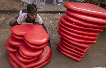 People prepare decorative items for Valentine's Day in Kolkata, India