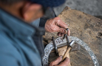 In pics: silver artisans in central China's Hunan
