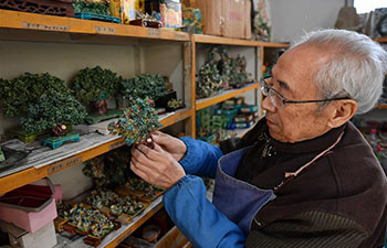 Inheritor of coloured glaze firing skill transforms waste into artwork in China's Shanxi