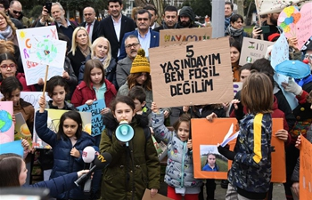 Turkish pupils attend rally to appeal for action on climate change in Istanbul