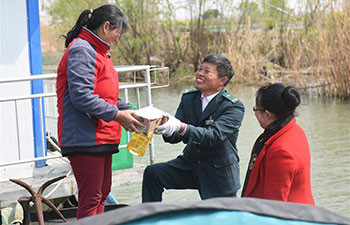 Pic story of postman Tang Zhenya in China's Jiangsu
