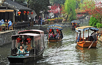 Tourists visit Nanxun Town, E China's Zhejiang