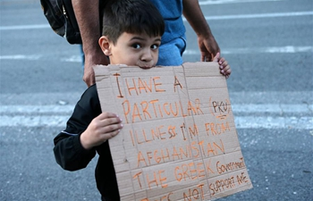 People protest against government's decision to demand refugees leave apartments in Athens, Greece
