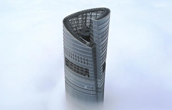 Shanghai Tower surrounded by thick fog