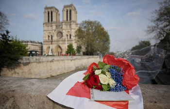 Flowers presented to cathedral of Notre Dame de Paris after huge fire