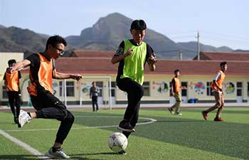 In pics: football boarding school in China's Shanxi rural area