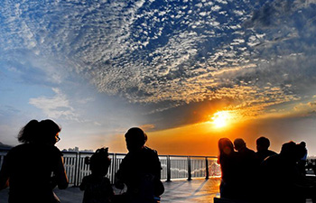 People view Tamsui River at sunset in China's Taiwan