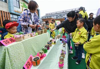 Campus charity bazaar held in Changxing County, E China's Zhejiang