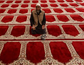 Afghan man prays during Ramadan in Kabul