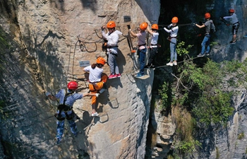 Tourists experience outdoor activities in Jianshi County, China's Hubei