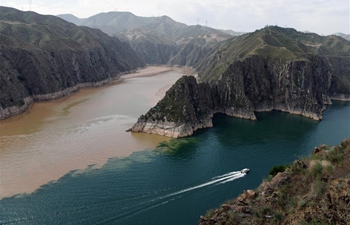 Scenery of two rivers meeting in Liujiaxia Reservoir in China's Gansu