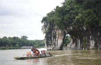 Tourists enjoy Dragon Boat Festival holiday across China