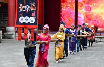 In pics: Distinctive etiquette of banquet for Gelao people in SW China