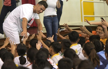 Cristiano Ronaldo interacts with primary school students in Singapore