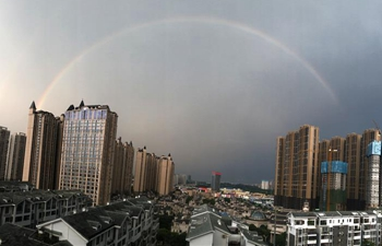 Rainbow appears after rainstorm over city proper of Nanning