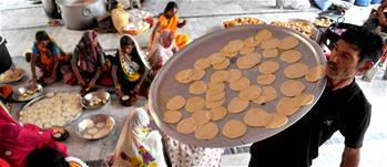 Kashmiri people prepares holy food for devotees in Jammu