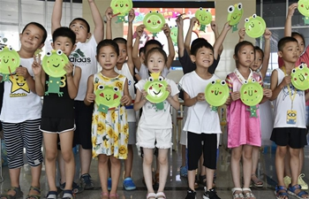 Various activities held in Hebei's library to enrich children's lives during summer vacation