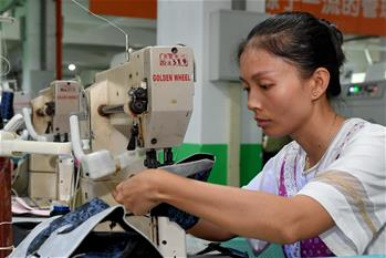 Workers make shoes at shoemaking factory in China's Fujian