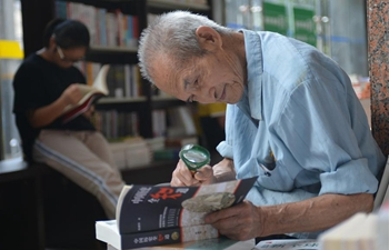 People read at Xinhua Bookstore in Changsha, C China