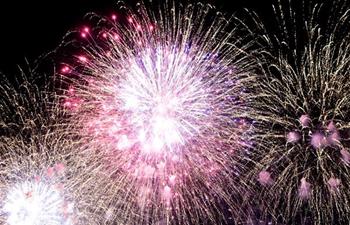 Fireworks illuminate sky during Taipei Dadaocheng Fireworks Festival