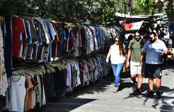 People prepare for upcoming Eid al-Adha festival in Damascus, Syria