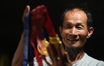 Pic story of 63-year-old Chinese marathon runner