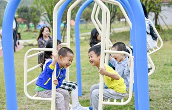 People have fun at Nantian Lake scenic area in Chongqing