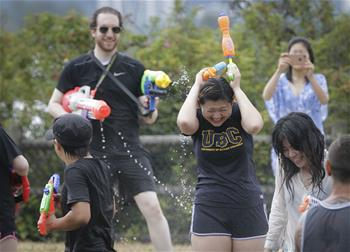 People participate in annual water fight in Vancouver, Canada