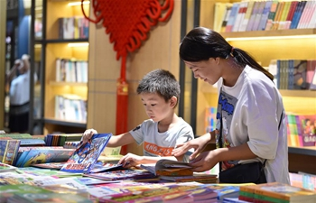 Readers browse books at Xinhua Bookstore in Dingzhou, China's Hebei