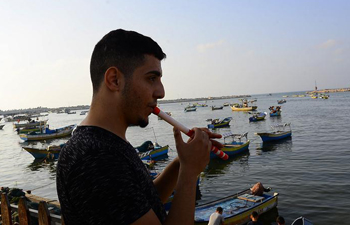 Feature: Gaza's disabled youth turns crutch into flute to express peace hope