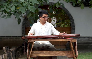 "Pic story: young man dedicated to promoting ""Guqin"" culture"
