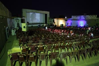 People watch movie in neighborhood of Khartoum North, Sudan