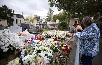 People mourn Jacques Chirac at Montparnasse cemetery in Paris