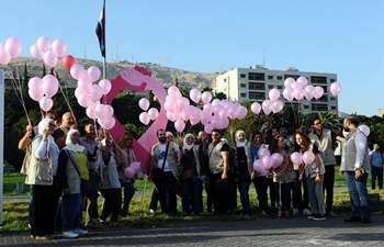 Syrians take part in rally to support early detection tests of breast cancer