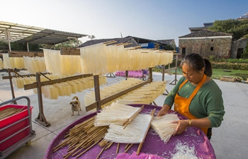 Villagers dry noodles in east China's Jiangxi
