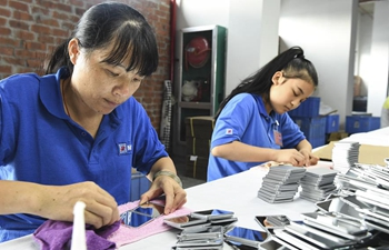 People work at factory in relocation area of south China's Guangxi