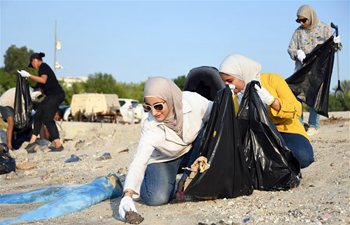 Volunteers participate in sea beach cleaning campaign in Kuwait
