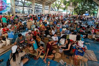 Residents take shelter after fire at residential area in Manila, Philippines